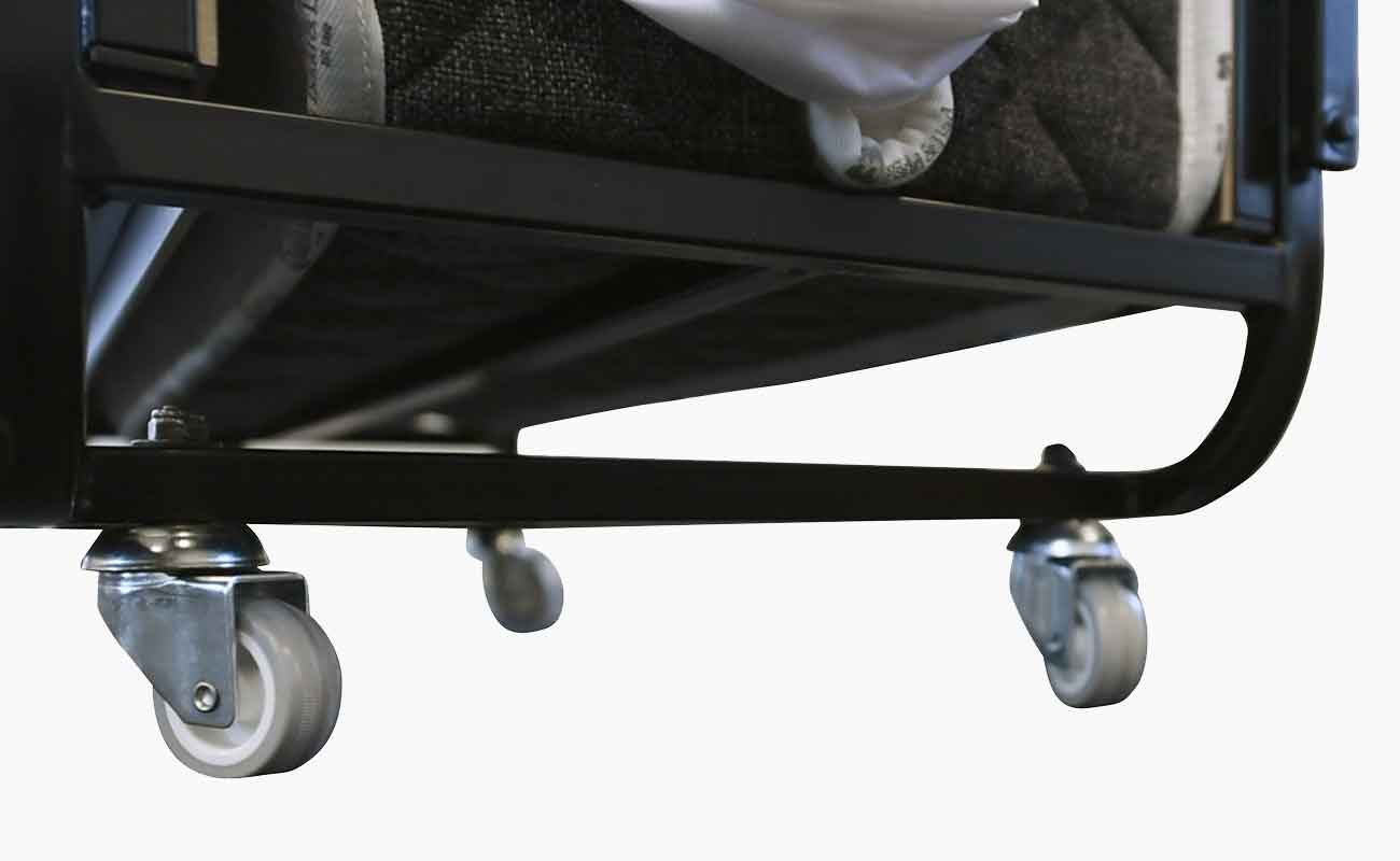 Close up of the Edward® Rollaway Folding Bed (Pin Pan Pun) swivel wheels from Bed & Bath, Inc. | A family owned company specializing in Rollaway Folding Beds & Guest Products